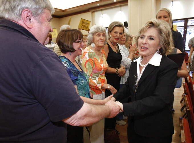 FILE — In this Oct. 13, 2010, file photo former California U. S. Senator Barbara Boxer shakes hands with supporters during a campaign stop in Lincoln, Calif. Boxer was assaulted and robbed Monday July 26, 2021, in the Jack London neighborhood of Oakland, Calif. A statement on Boxer's verified Twitter account says the assailant pushed her in the back, stole her cell phone and jumped into a waiting car. The 80-year-old Boxer was not seriously injured. (AP Photo/Rich Pedroncelli, File)