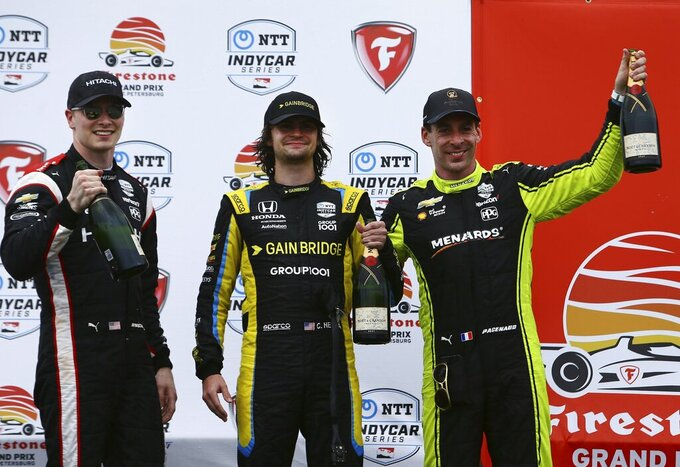 Second place Team Penske driver Josef Newgarden, left, first place Andretti Autosport driver Colton Herta, middle, and third place Team Penske driver Simon Pagenaud celebrate after completing the Grand Prix of St. Petersburg, Sunday, April 25, 2021 in St. Petersburg, Fla. (Luis Santana/Tampa Bay Times via AP)