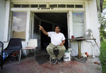 In this July 9, 2019 photo, John Earle gestures while talking outside his second-hand store in Gainesville, Ala. According to Earle, the $2 billion Tennessee-Tombigbee Waterway, which runs through northeast Mississippi and western Alabama, hasn't helped the small town. (AP Photo/Jay Reeves)