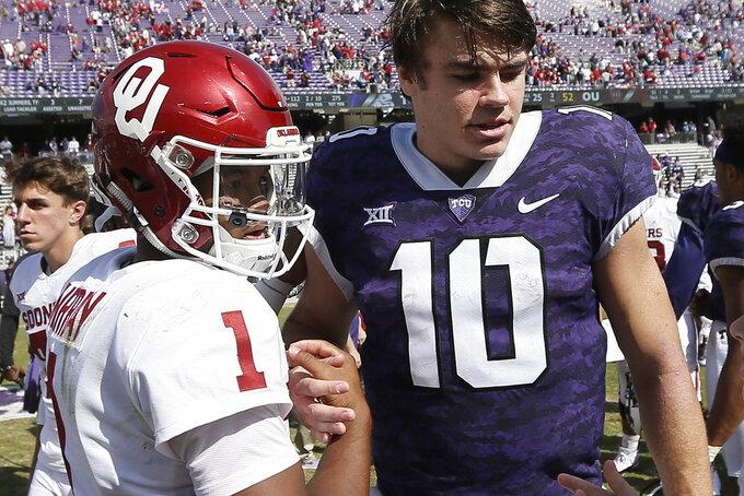 Oklahoma quarterback Kyler Murray (1) and TCU quarterback Michael Collins (10) greet each other after an NCAA college football game, Saturday, Oct. 20, 2018, in Fort Worth, Texas. Oklahoma won 52-27. (AP Photo/Brandon Wade)