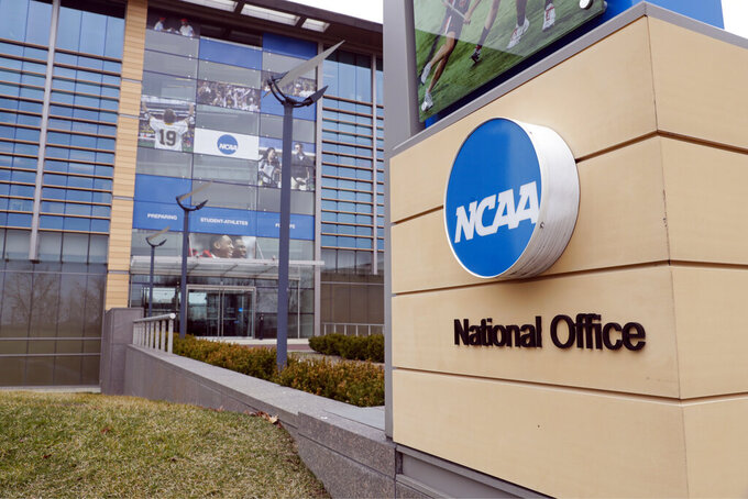 FILE - In this March 12, 2020, file photo, the national office of the NCAA in Indianapolis is shown. The NCAA announced Monday, Nov. 16, 2020, it plans to hold the entire 2021 men's college basketball tournament in one geographic location to mitigate the risks of COVID-19 and is in talks with Indianapolis to be the host city. (AP Photo/Michael Conroy, File)
