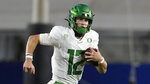 FILE - In this Dec 18, 2020, file photo, Oregon quarterback Tyler Shough (12) runs the ball during the first half of an NCAA college football game for the Pac-12 Conference championship against Southern California in Los Angeles. Shough transferred to Texas Tech. (AP Photo/Ashley Landis, File)