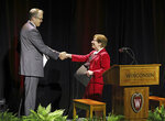 University of Wisconsin Chancellor Rebecca Blank, right, shakes hands with Chris McIntosh after introducing him as the university's new athletic director in Madison, Wis., Wednesday, June 2, 2021. (Amber Arnold/Wisconsin State Journal via AP)