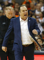 Notre Dame head coach Mike Brey yells at a referee during the first half of an NCAA college basketball game against Virginia in Charlottesville, Va., Saturday, Feb. 16, 2019. (AP Photo/Steve Helber)