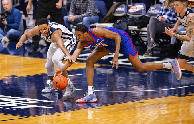 Butler forward Bryce Nze (10), left, and DePaul center Nick Ongenda (14) battle for the ball during the second half of an NCAA college basketball game, Saturday, Feb. 29, 2020, in Indianapolis. (AP Photo/Doug McSchooler)