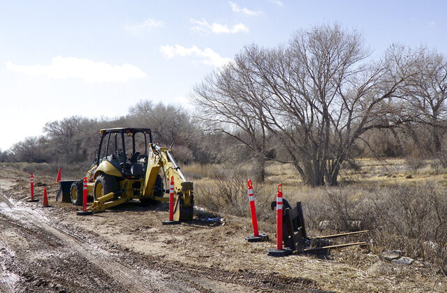 In this Wednesday, Feb. 12, 2020 photo, heavy equipment is used to prep for work on the Western Spirit Transmission Line in Bosque, N.M. Critics fear the project's huge towers and miles of high-voltage lines will spoil their rural quality of life by obstructing pristine vistas, impacting wildlife and undermining tourism-related income and property values.   (Adolphe Pierre-Louis/The Albuquerque Journal via AP)