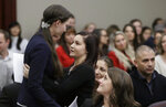Former gymnast Rachael Denhollander, left, is hugged by Kaylee Lorincz after giving her victim impact statement during the seventh day of Larry Nassar's sentencing hearing Wednesday, Jan. 24, 2018, in Lansing, Mich. Nassar has admitted sexually assaulting athletes when he was employed by Michigan State University and USA Gymnastics, which is the sport's national governing organization and trains Olympians. (AP Photo/Carlos Osorio)