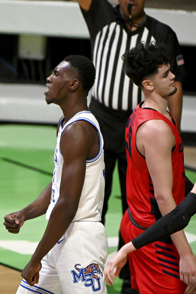 Memphis center Moussa Cisse (32) reacts to drawing a foul from Dayton forward Mustapha Amzil (30) in the second half of an NCAA college basketball game in the first round of the NIT Tournament, Saturday, March 20, 2021, in Denton, Texas. Memphis won 71-60. (AP Photo/Matt Strasen)