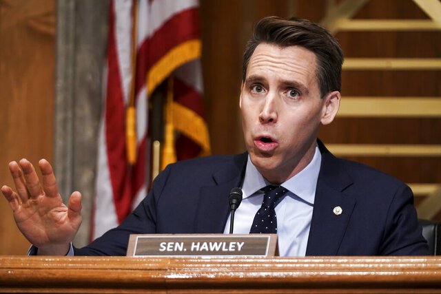 FILE - In this Dec. 16, 2020 file photo, Sen. Josh Hawley, R-Mo., asks questions during a Senate Homeland Security & Governmental Affairs Committee hearing to discuss election security and the 2020 election process on Capitol Hill in Washington.  Walmart apologized on Wednesday, Dec. 30, for a tweet that called Hawley a sore loser for contesting the U.S. presidential election. The tweet from Walmart was in response to Hawley's tweet announcing his plans to raise objections next week when Congress meets to affirm President-elect Joe Biden's victory in the election.  (Greg Nash/Pool via AP, File)