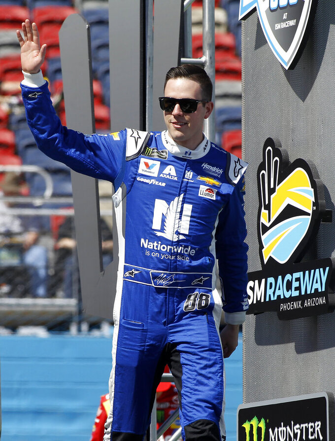 Alex Bowman waves to the crowd during driver introductions prior to the start of the NASCAR Cup Series auto race at ISM Raceway, Sunday, March 10, 2019, in Avondale, Ariz. (AP Photo/Ralph Freso)