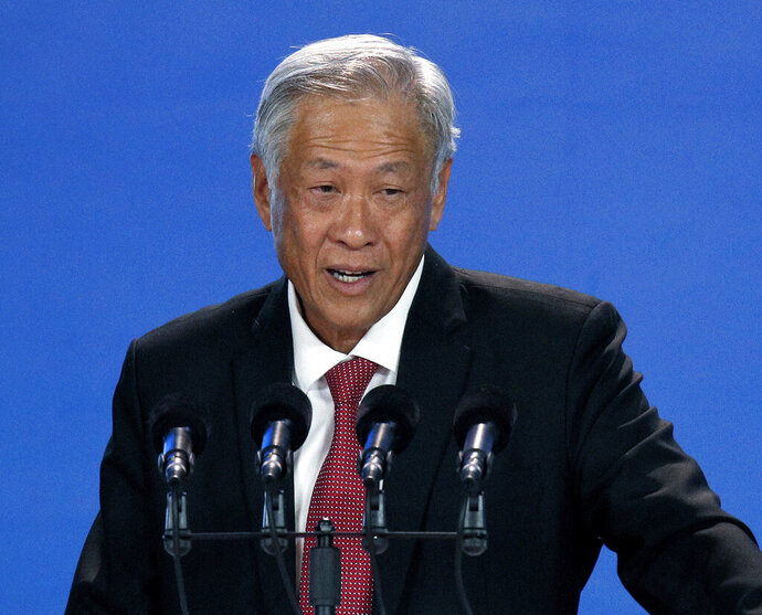 "FILE - In this Oct. 25, 2018, file photo, Singapore's Defense Minister Ng Eng Hen speaks during the Xiangshan Forum, a gathering of the region's security officials, in Beijing. Ng said Saturday, Feb. 16, 2019 at the Munich Security Conference in Germany that confidence building measures were helping ""minimize the risk of miscalculations and build trust and confidence among militaries."" (AP Photo/Andy Wong, File)"