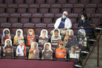 Crowd size is limited and cutouts of fans occupy some of the seats in Cassell Coliseum prior to the start of an NCAA college basketball between Penn  State and Virginia Tech, Tuesday, Dec. 8, 2020 in Blacksburg Va. (Matt Gentry/The Roanoke Times via AP, Pool)