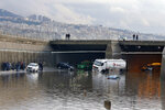Vehicles are stuck in a flooded tunnel in Beirut's southern suburb of Ouzai, Lebanon, Monday, Dec. 9, 2019. A rainstorm paralyzed parts of Lebanon's capital on Monday turning streets to small rivers stranding motorists inside their vehicles while some people had their homes flooded with water causing wide material damage. (AP Photo/Bilal Hussein)