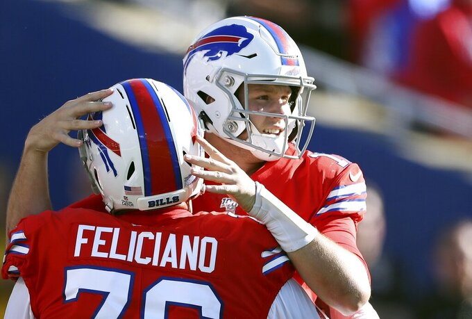 Buffalo Bills quarterback Josh Allen, right, celebrates with guard Jon Feliciano after throwing a touchdown pass to Cole Beasley in the second half of an NFL football game against the Miami Dolphins, Sunday, Oct. 20, 2019, in Orchard Park, N.Y. (AP Photo/Ron Schwane)