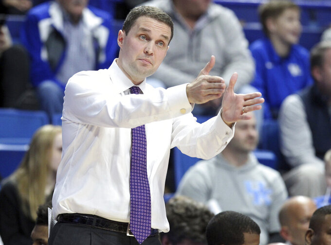 LSU head coach Will Wade directs his team during the first half of an NCAA college basketball game against Kentucky in Lexington, Ky., Tuesday, Feb. 12, 2019. (AP Photo/James Crisp)