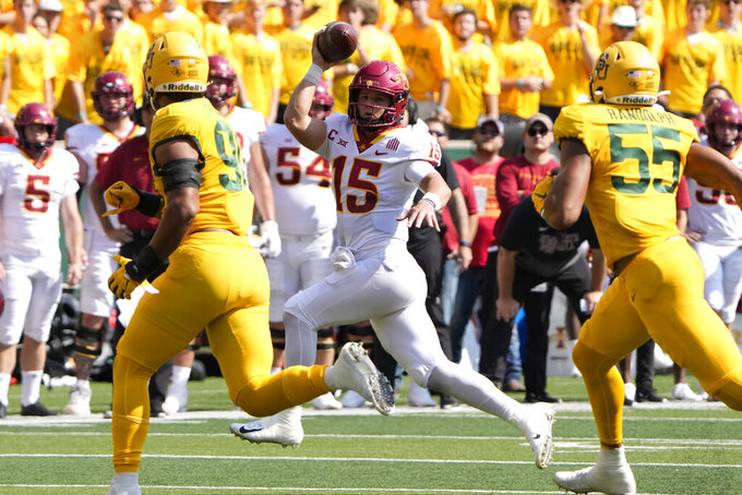 Iowa State quarterback Brock Purdy (15) runs as he looks to pass against Baylor during the first half of an NCAA college football game, Saturday, Sept. 25, 2021, in Waco, Texas. (AP Photo/Jim Cowsert)