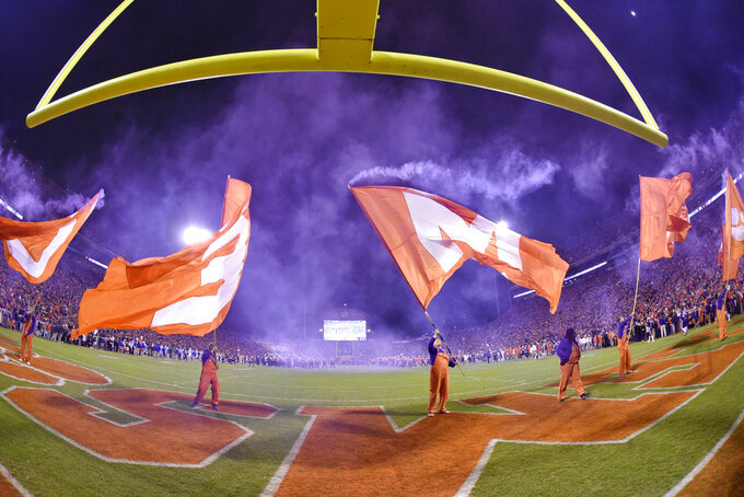 Clemson cheer squads rally the team and fans before an NCAA college football game against Duke on Saturday, Nov. 17, 2018, in Clemson, S.C. Clemson won 35-6. (AP Photo/Richard Shiro)