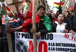 Anti-government protesters against the reelection of President Evo Morales gather just meters away from the presidential palace in La Paz, Bolivia, Saturday, Nov. 9, 2019. Growing dissension in police ranks posed a new threat to President Evo Morales, who claimed victory after the Oct. 20 vote but has since faced protests in which three people have been killed and hundreds injured. (AP Photo/Juan Karita)