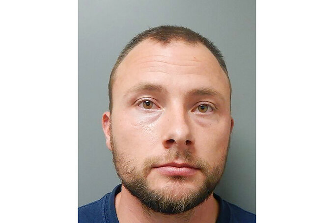 """FILE - This Dec. 10, 2020 photo provided by the Ouachita Parish Sheriff's Office shows Louisiana State Police Trooper Jacob Brown. Graphic body camera video kept secret for more than two years shows Brown pummeling Black motorist Aaron Larry Bowman 18 times with a flashlight, an attack Brown defended as """"pain compliance."""" (Ouachita Parish Sheriff's Office via AP)"""