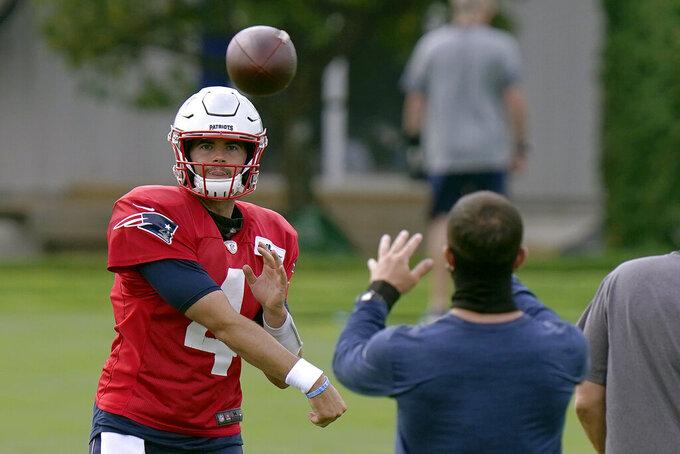 New England Patriots quarterback Jarrett Stidham throws during an NFL football training camp practice, Tuesday, Aug. 25, 2020, in Foxborough, Mass. (AP Photo/Steven Senne, Pool)