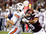FILE - In this Oct. 6, 2018, file photo, Mississippi State defensive end Montez Sweat (9) forces Auburn quarterback Jarrett Stidham (8) to fumble as he attempts to pass during the second half of an NCAA college football game, in Starkville, Miss. A main reason Mississippi State is allowing fewer than 13 points per game is a defensive front anchored by end Montez Sweat and tackle Jeffery Simmons. Sweat has 18 sacks in 19 career games. Mississippi State plays at LSU on Saturday, Oct. 20.  (AP Photo/Rogelio V. Solis)