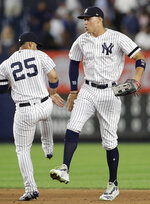 New York Yankees' second baseman Gleyber Torres (25), and right fielder Aaron Judge celebrate the Yankees' 4-1 victory over the Texas Rangers in a baseball game Wednesday, Sept. 4, 2019, in New York. Both Torres and Judge hit home runs in the game. (AP Photo/Kathy Willens)
