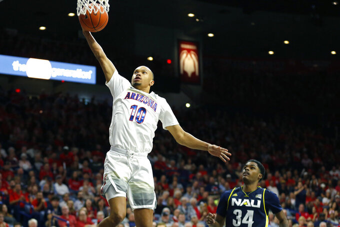 Arizona guard Jemarl Baker Jr. (10) goes to the basket in front of Northern Arizona guard Ted McCree during the second half of an NCAA college basketball game Wednesday, Nov. 6, 2019, in Tucson, Ariz. (AP Photo/Rick Scuteri)