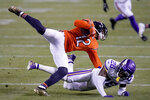 Chicago Bears wide receiver Allen Robinson II (12) catches a pass as Minnesota Vikings cornerback Chris Jones (26) defends during the second half of an NFL football game Monday, Nov. 16, 2020, in Chicago. (AP Photo/Nam Y. Huh)