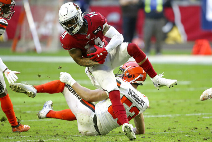 Arizona Cardinals wide receiver Damiere Byrd (14) is hit by Cleveland Browns middle linebacker Joe Schobert (53) during the first half of an NFL football game, Sunday, Dec. 15, 2019, in Glendale, Ariz. (AP Photo/Ross D. Franklin)