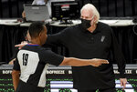 San Antonio Spurs head coach Gregg Popovich, right, has words with referee James Capers, left, during the second half of an NBA basketball game against the Portland Trail Blazers in Portland, Ore., Monday, Jan. 18, 2021. (AP Photo/Steve Dykes)