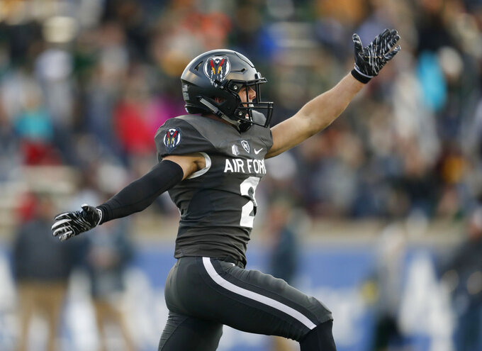 Air Force defensive back Jeremy Fejedelem celebrates after his interception to stop a Colorado State drive deep in Air Force territory in the second half of an NCAA college football game Thursday, Nov. 22, 2018, at Air Force Academy, Colo. Air Force won 27-19. (AP Photo/David Zalubowski)