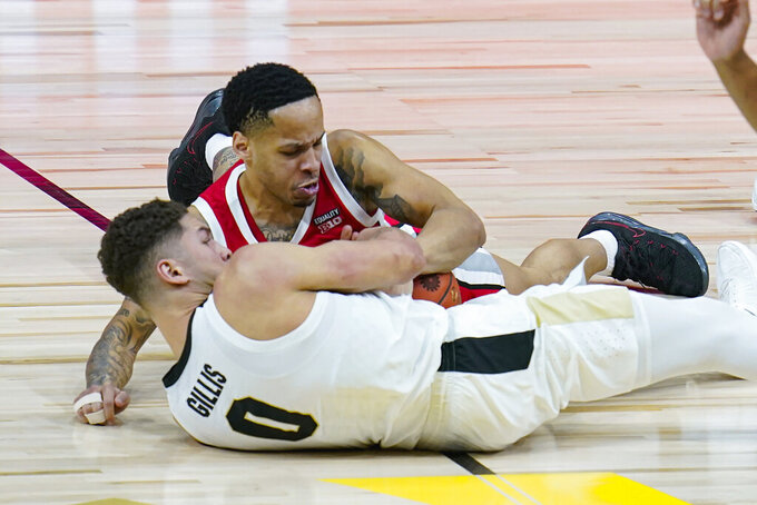 Ohio State guard CJ Walker, top and Purdue forward Mason Gillis (0) fight for a loose ball in the first half of an NCAA college basketball game at the Big Ten Conference tournament in Indianapolis, Friday, March 12, 2021. (AP Photo/Michael Conroy)