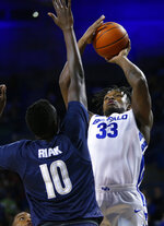 Buffalo forward Nick Perkins (33) looks to shoot against Akron center Deng Riak (10) during the first half of an NCAA college Basketball game, Tuesday, Feb. 26, 2019, in Buffalo N.Y. (AP Photo/Jeffrey T. Barnes)