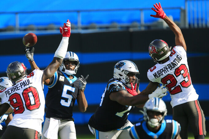 Carolina Panthers quarterback Teddy Bridgewater (5) works in the pocket against the Tampa Bay Buccaneers during the first half of an NFL football game, Sunday, Nov. 15, 2020, in Charlotte , N.C. (AP Photo/Brian Blanco)