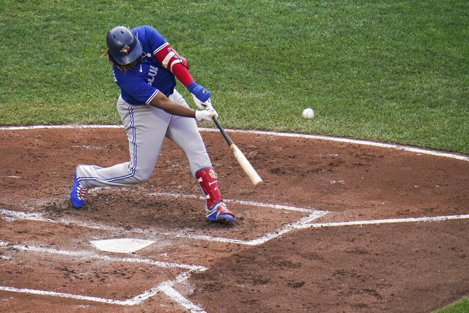 Toronto Blue Jays' Vladimir Guerrero Jr. connects for a solo home run off Baltimore Orioles starting pitcher Dean Kremer during the third inning of the first game of a baseball doubleheader, Saturday, Sept. 11, 2021, in Baltimore. (AP Photo/Julio Cortez)