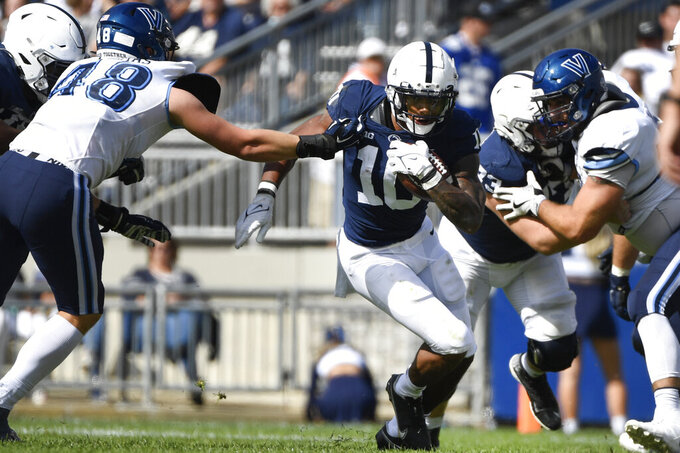 Penn State running back John Lovett (23) breaks a tackle-attempt by Villanova linebacker Owen Thomas (48) during an NCAA college football game in State College, Pa., on Saturday, Sept. 25, 2021. (AP Photo/Barry Reeger)