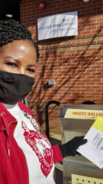 FILE - In this Dec. 2020, photo taken and provided by Cynthia Vaughn, is Vaughn outside College Park Library dropping her ballot off ahead of the January 2021 runoff elections in Atlanta. Ballot drop boxes were enormously popular during the 2020 election, with few problems reported. Yet they have drawn the attention of Republican lawmakers in key states who say security concerns warrant new restrictions. (Cynthia Vaughn via AP)