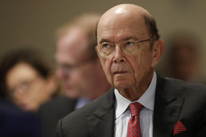 FILE - In this Aug. 1, 2019, file photo U.S. Commerce Secretary Wilbur Ross attends a meeting of the 17th Latin American Infrastructure Leadership Forum, in Brasilia, Brazil. The U.S. government gave chipmakers and technology companies a 90-day extension to sell products to technology giant Huawei. (AP Photo/Eraldo Peres, File)