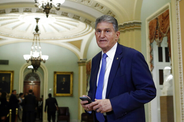 FILE - In this Wednesday Jan 29, 2020 file photo, Sen. Joe Manchin, D-W.Va., walks to the Senate chamber after a break in the impeachment trial of President Donald Trump at the U.S. Capitol in Washington. The U.S. Postal Service is considering closing post offices across the country, sparking worries ahead the anticipated surge of mail-in ballots in the 2020 elections, U.S. Sen Joe Manchin and a union leader said Wednesday, July 29, 2020.  (AP Photo/Steve Helber, File)