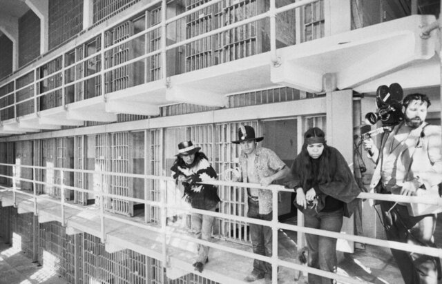 FILE - In this Nov. 19, 1969, file photo, part of a band of Native Americans look over the main cell block of Alcatraz after occupying the island in San Francisco. The week of Nov. 18, 2019, marks 50 years since the beginning of a months-long Native American occupation at Alcatraz Island in the San Francisco Bay. The demonstration by dozens of tribal members had lasting effects for tribes, raising awareness of life on and off reservations, galvanizing activists and spurring a shift in federal policy toward self-determination. (AP Photo/RWK, File)
