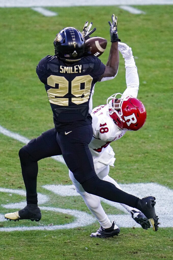 Purdue cornerback Simeon Smiley (29) breaks up a pass to Rutgers wide receiver Bo Melton (18) during the first quarter of an NCAA college football game in West Lafayette, Ind., Saturday, Nov. 28, 2020. (AP Photo/Michael Conroy)