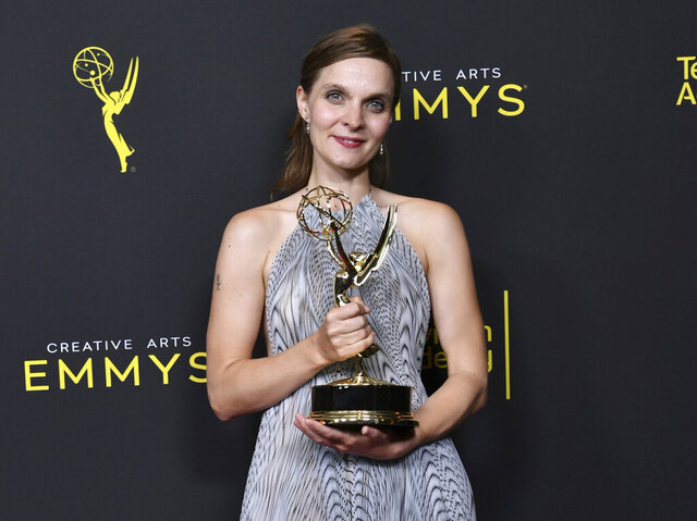 FILE - This Sept. 15, 2019 photo shows composer Hildur Guðnadóttir posing in the press room with the award for outstanding music composition for a limited series, movie or special for