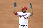 Washington Nationals' Luis Garcia reacts after he drove in two runs with his single during the sixth inning of a baseball game against the New York Mets, Sunday, Sept. 27, 2020, in Washington. (AP Photo/Nick Wass)