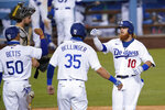 Los Angeles Dodgers' Justin Turner (10) celebrates his three-run home run with Cody Bellinger (35) and Mookie Betts (50) during the eighth inning of the team's baseball game against the San Diego Padres on Wednesday, Aug. 12, 2020, in Los Angeles. (AP Photo/Marcio Jose Sanchez)