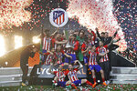 Atletico players celebrate with the trophy after winning the Europa League Final soccer match between Marseille and Atletico Madrid at the Stade de Lyon in Decines, outside Lyon, France, Wednesday, May 16, 2018. (AP Photo/Francois Mori)