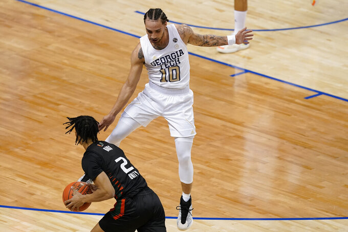 Georgia Tech guard Jose Alvarado (10) guards Miami guard Isaiah Wong (2) during the first half of an NCAA college basketball game in the quarterfinal round of the Atlantic Coast Conference tournament in Greensboro, N.C., Thursday, March 11, 2021. (AP Photo/Gerry Broome)
