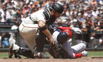 San Francisco Giants catcher Stephen Vogt, top, checks on Washington Nationals' Anthony Rendon after Rendon was hit by a pitch during the fourth inning of a baseball game in San Francisco, Wednesday, Aug. 7, 2019. (AP Photo/Jeff Chiu)