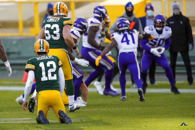 Green Bay Packers' Aaron Rodgers watches as Minnesota Vikings' Eric Wilson (50) reacts after recovering Rodger's fumble during the second half of an NFL football game Sunday, Nov. 1, 2020, in Green Bay, Wis. The Vikings won 28-22. (AP Photo/Matt Ludtke)