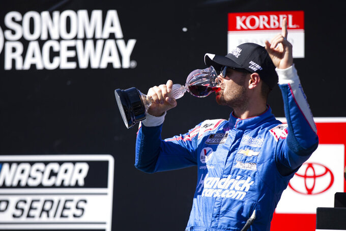 Kyle Larson celebrates his victory in a NASCAR Cup Series race, Sunday, June 6, 2021, at Sonoma Raceway in Sonoma, Calif. (AP Photo/D. Ross Cameron)