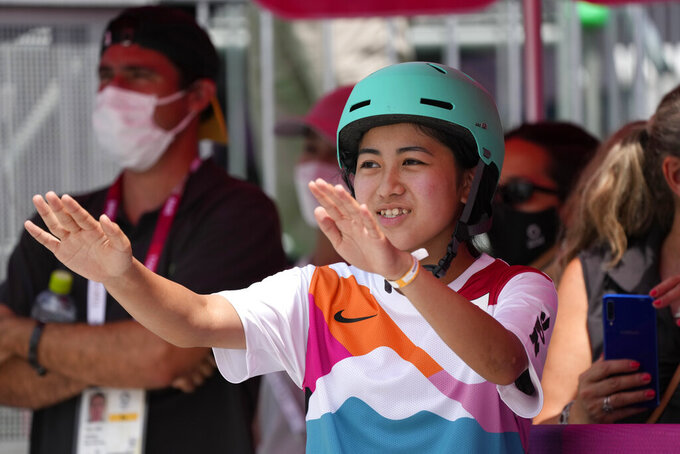 Funa Nakayama of Japan watches the other athletes in the women's street skateboarding finals at the 2020 Summer Olympics, Monday, July 26, 2021, in Tokyo, Japan. (AP Photo/Ben Curtis)